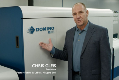 Chris Gleis , President of Factor Forms beside new Domino Label press